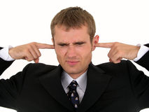 Hombre de negocios que pone los dedos en oídos Fotos de archivo libres de regalías