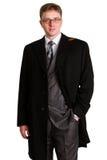 Hombre de negocios que presenta en un traje Imagen de archivo