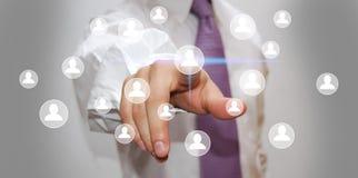 Hombre de negocios que presiona el botón de alta tecnología Imagenes de archivo
