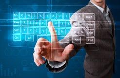 Hombre de negocios que presiona el tipo virtual de teclado Imagen de archivo libre de regalías