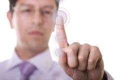 Hombre de negocios que presiona un botón Imágenes de archivo libres de regalías