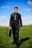 Hombre de negocios que recorre Foto de archivo