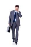 Hombre de negocios que recorre adelante Imagen de archivo