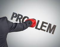 Hombre de negocios que rompe problema Foto de archivo libre de regalías