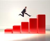 Hombre de negocios que salta en un gráfico 3d Fotografía de archivo