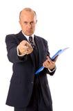 Hombre de negocios que señala con la pluma Imágenes de archivo libres de regalías