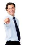 Hombre de negocios que señala en marco Imagen de archivo libre de regalías