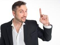 Hombre de negocios que señala encima del finger aislado en el fondo blanco Imagenes de archivo