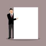 Hombre de negocios que señala a la cartelera Fotografía de archivo libre de regalías