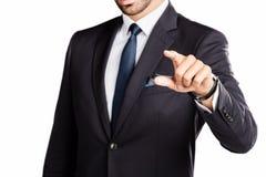 Hombre de negocios que señala su dedo Imagen de archivo libre de regalías