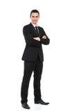 Hombre de negocios que se coloca con los brazos cruzados Imágenes de archivo libres de regalías