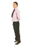 Hombre de negocios que se coloca en las puntas Foto de archivo libre de regalías