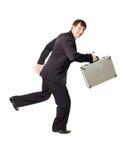 Hombre de negocios que se ejecuta con la cartera Imagen de archivo libre de regalías