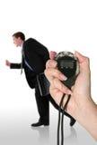 Hombre de negocios que se ejecuta tarde Fotos de archivo libres de regalías