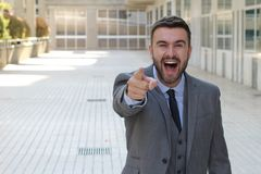Hombre de negocios que se ríe de usted imágenes de archivo libres de regalías