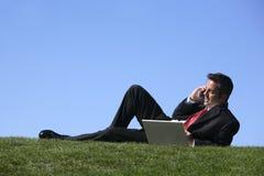 Hombre de negocios que se relaja Foto de archivo libre de regalías