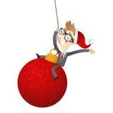 Hombre de negocios que se sienta en el ornamento de la bola de la Navidad stock de ilustración