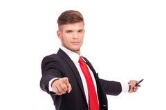 Hombre de negocios que señala y que presenta Fotografía de archivo