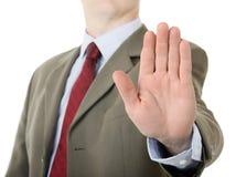 Hombre de negocios que soporta gesto de mano de la palma de la parada Imagen de archivo libre de regalías