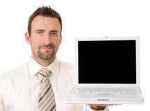 Hombre de negocios que soporta la computadora portátil con el camino de recortes Imágenes de archivo libres de regalías