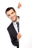 Hombre de negocios que sostiene el cartel en blanco Imagen de archivo libre de regalías
