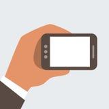 Hombre de negocios que sostiene el teléfono móvil con la pantalla en blanco Imágenes de archivo libres de regalías
