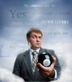 Hombre de negocios que sostiene la bola mágica imágenes de archivo libres de regalías