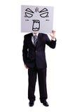 Hombre de negocios que sostiene la cartelera enojada de la expresión Imagen de archivo libre de regalías