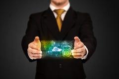 Hombre de negocios que sostiene la nube de los datos Foto de archivo libre de regalías