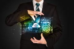 Hombre de negocios que sostiene la nube de los datos Fotos de archivo libres de regalías