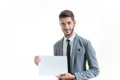 Hombre de negocios que sostiene la tarjeta Fotos de archivo libres de regalías