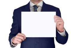 Hombre de negocios que sostiene la tarjeta en blanco Imagenes de archivo