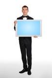 Hombre de negocios que sostiene plasma Imagen de archivo libre de regalías