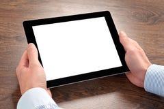 Hombre de negocios que sostiene un ordenador de la tableta con la pantalla aislada Imagen de archivo libre de regalías