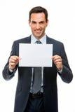Hombre de negocios que sostiene un papel en blanco Imágenes de archivo libres de regalías