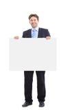 Hombre de negocios que sostiene una bandera Imagen de archivo