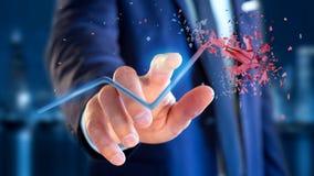 Hombre de negocios que sostiene una flecha financiera que sube y explosing en Imagen de archivo libre de regalías