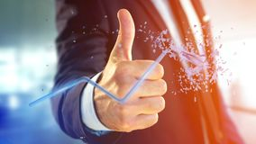 Hombre de negocios que sostiene una flecha financiera que sube y explosing en Imagen de archivo