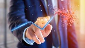 Hombre de negocios que sostiene una flecha financiera que sube y explosing en Fotografía de archivo