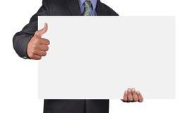 Hombre de negocios que sostiene una tarjeta Fotos de archivo