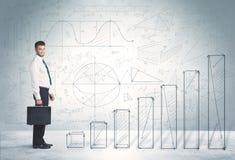 Hombre de negocios que sube para arriba a mano concepto dibujado de los gráficos Foto de archivo libre de regalías