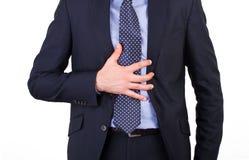 Hombre de negocios que sufre de ardor de estómago. Imagen de archivo libre de regalías