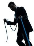 Hombre de negocios que tira de una silueta de la cuerda Imágenes de archivo libres de regalías