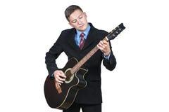 Hombre de negocios que toca la guitarra Foto de archivo libre de regalías