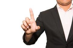 Hombre de negocios que toca una pantalla imaginaria en el backgroun blanco fotografía de archivo