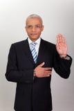Hombre de negocios que toma juramento fotos de archivo