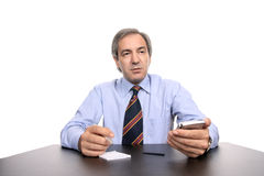 Hombre de negocios que trabaja en su escritorio Fotos de archivo