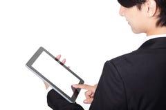Hombre de negocios que usa la almohadilla táctil Fotografía de archivo libre de regalías