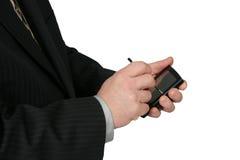 Hombre de negocios que usa PDA imagenes de archivo