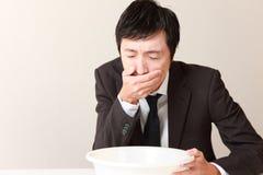Hombre de negocios que vomita Imagen de archivo